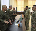 From left, U.S. Marine Corps Sgt. Maj. Nicholas Deabreu, 1st Sgt. Darrin Leonhart, 1st Sgt. David Marbut, all assigned to Black Sea Rotational Force 13, discuss leadership courses with Georgian army brigade 130320-M-ZP546-051.jpg