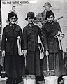 From left to right are Marine Corps Women's Marine Reserve Privates Minette Gaby, May English and Lillian Patterson posting recruiting posters on a wall in 1918 New York City, Women Marines at work, ca. 1918 (6034991773) (cropped).jpg