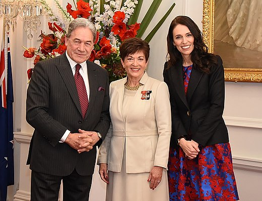Ardern with Deputy Prime Minister Winston Peters and Governor-General Dame Patsy Reddy at the swearing-in of the Cabinet on 26 October 2017 GGNZ Swearing of new Cabinet - Jacinda Ardern & Winston Peters.jpg