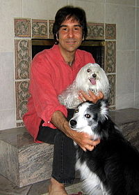 Gary Francione sitting with his two rescue dogs, Mollie and Katie