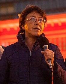 La Riva holding a microphone
