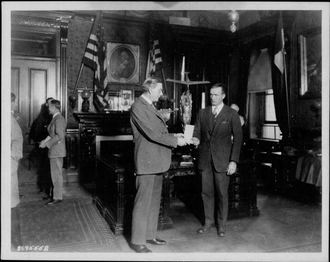 Godfrey Lowell Cabot - Godfrey Cabot (left) presenting a trophy to Secretary of the Navy