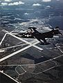 Grumman F9F-2 Panther in flight over Naval Air Station Patuxent River, in the 1950s (NH 101804-KN).jpg