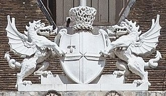 "Coat of arms of the City of London - Arms above the southern entrance to Guildhall, by George Dance (1788), surmounted by a ""Muscovy hat"" rather than a helm and crest"