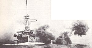 HMS Illustrious (1896) firing guns.jpg