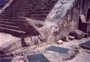 Kukulkan at the base of the west face of the n...