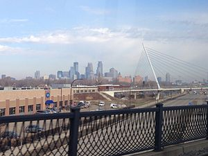 Martin Olav Sabo Bridge - Downtown Minneapolis and the Martin Olav Sabo Bridge from the Hiawatha Avenue bridge over Lake Street, on the METRO Blue Line light rail train.
