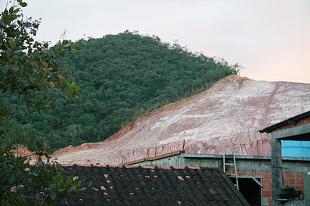 Deforestation for the use of clay in the Brazilian city of Rio de Janeiro. The hill depicted is Morro da Covanca, in Jacarepagua Hillside deforestation in Rio de Janeiro.jpg