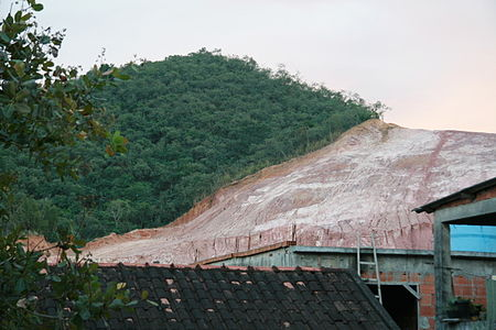 Deforestation of native rain forest in Rio de Janeiro City for extraction of clay for civil engineering (2009). An example of non-sustainable forest management. Hillside deforestation in Rio de Janeiro.jpg