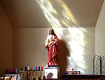 Holy Family Catholic Church (Oldenburg, Indiana) - interior, Sacred Heart of Jesus statue and stained glass shadow.jpg