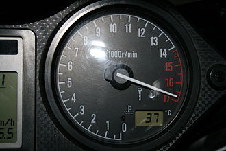 Redline - Tachometer showing red lines above 14,000 rpm.