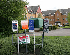 mortgage purchases helping profitlenders homebuyers and property owners looking to refinance British for sale signs.