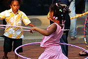 Children playing with hula hoops.