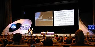 IAU definition of planet - Plenary session of the IAU General Assembly on August 24, 2006. Votes were cast by raising yellow cards.