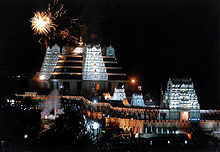 Iskon temple at night with fireworks