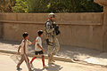 Iraqi Children Tag Along With Soldier During Patrol DVIDS98718.jpg