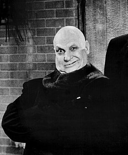 Jackie Coogan as Uncle Fester (The Addams Family, 1966).jpg
