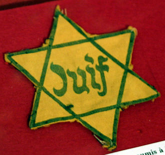 Religious persecution - During Nazi rule, Jews were forced to wear yellow stars identifying them as such. Jews are an ethno-religious group and Nazi persecution was based on their race