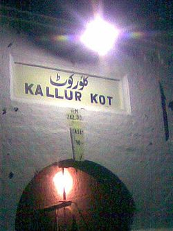 Nameplate of 100 years old Kallur Kot Station under the lamp