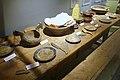 Karmsund folkemuseum (Regional Museum) Haugesund Norway 2020-06-10 Langbord 1600-t Langbenk dekketøy bestikk foldekniver tallerkner treboller treskjeer ølkjenge (Matrettar 1700-talet Måltid) Wooden 16c table bench plates etc.jpg