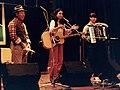 Kavisha Mazzella (Australian musician) and friends at Georgetown Folk Festival, Australia, 1996 (Tony Rees photograph).jpg