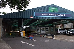 "Kensington (Olympia) station - The former Motorail terminal, seen here in 2009. Since Motorail services here ceased, the building has been designated ""Olympia Motorail Car Park P4""."