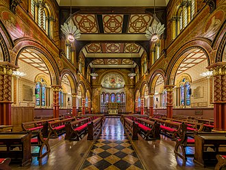 The Grade I listed King's College London Chapel on the Strand Campus was redesigned in 1864 by Sir George Gilbert Scott. King's College London Chapel 2, London - Diliff.jpg