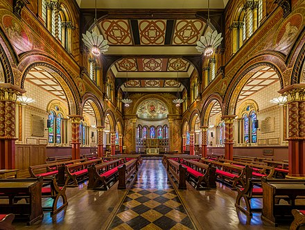 The Grade I listed King's College London Chapel on the Strand Campus seen today was redesigned in 1864 by Sir George Gilbert Scott King's College London Chapel 2, London - Diliff.jpg
