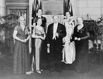 The Famous Five (Canada) - Unveiling of a plaque commemorating the Famous Five, June 11, 1938.  (Front row, L–R): Muir Edwards, daughter-in-law of Henrietta Muir Edwards; J. C. Kenwood, daughter of Judge Emily Murphy; Mackenzie King; Nellie McClung. (Rear row, L–R): Senators Iva Campbell Fallis, Cairine Wilson.