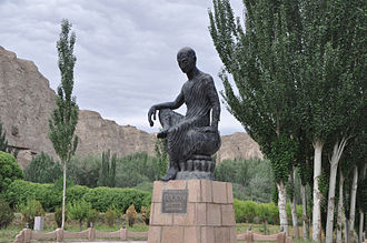Diamond Sutra - Statue of Kumārajīva in front of the Kizil Caves in Kuqa, Xinjiang province, China