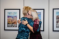 Kyrsten Sinema hugging a woman.jpg