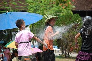 Songkran (Lao) - Pii Mai celebration, flour throwing
