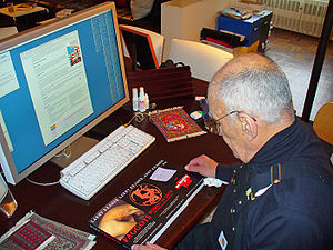 Larry Kramer - Kramer at home in 2007, reviewing the new Grove Press editions of his work. His Wikipedia article is shown on the computer.