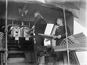 QF 6 pounder 10 cwt gun - Image: Loading 6pdr 10cwt Guns HMS Mackay Harwich 1943