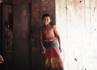 Lungi - A boy in a village of Narail, Bangladesh wearing a lungi with simple twist knot
