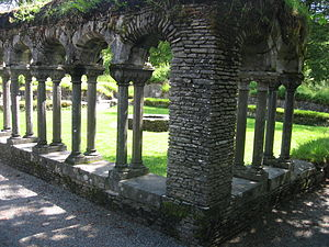 Lyse Abbey - View of the monastery courtyard through the remains of the cloister, facing south-east