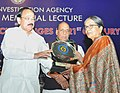 M. Venkaiah Naidu honouring Smt. Achemma Vinod, at an event to deliver the 4th R.V. Raju Memorial Lecture on 'National Security Challenges in 21st Century', organised by the National Investigation Agency, in New Delhi.jpg