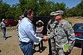 Maj. Gen. John Peabody greets U.S. Rep. John Garamendi (14347550294).jpg