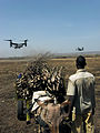 Mali boy looks at oncoming CV-22 Ospreys.jpg