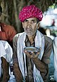 Man with a pink turban drinking tea, Rajasthan (6358884265).jpg