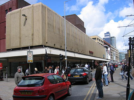The High Street in 2009. The original yellow tiles remain. Manchester Arndale High Street.jpg