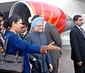 Manmohan Singh being welcomed by the Indian Ambassador in Germany, Ms. Meera Shankar on his arrival at Frankfurt Airport at the transit halt on the way to his visit to the United States, on September 22, 2008.jpg