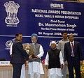 Manmohan Singh giving away the First National Award for Outstanding Entrepreneurship in Micro & Small Enterprises to Shri Satish Waman Wagh of Maharashtra, at the presentation of National Awards-2007 for Micro.jpg