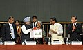 Manmohan Singh releasing a commemorative stamp, at the inauguration of the High Level Segment of the 11th Conference of Parties to the Convention on Biological Diversity, in Hyderabad, Andhra Pradesh. The Governor.jpg