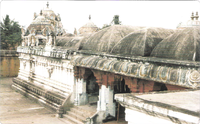an image depicting a series of conical roofs of a temple