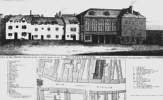 Marshalsea - Southern front of the north side of the first Marshalsea, 1773. The building with columns contained a courthouse. The door to the notorious strong room, where prisoners were held next to the prison sewer, is farthest on the right.