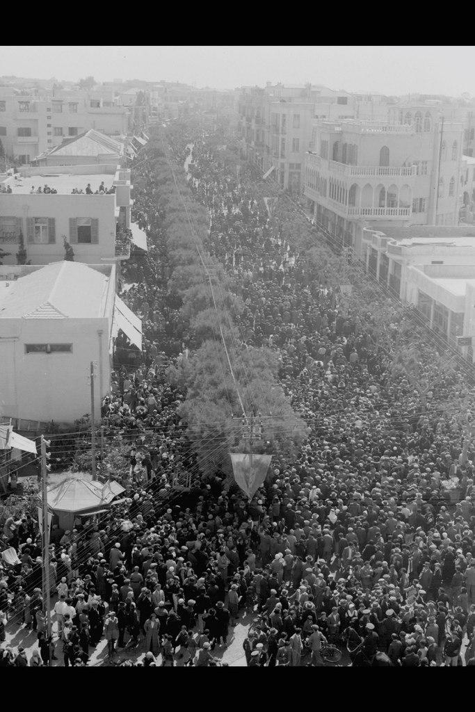 "Masses streaming through Allenby Street during the ""adloyada"" in Tel Aviv"