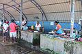 Mature women cleaning fish Sri Lanka.jpg