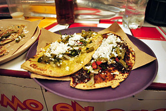 Tlacoyo - Tlacoyo with green and chile pasilla sauce