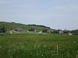 The eastern part of the hamlet of Millarville, looking ENE from Highway 549. Highways 22 is visible near the right edge of the image.